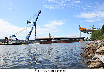 Bridge lift from the bay whith crane on board Public project...