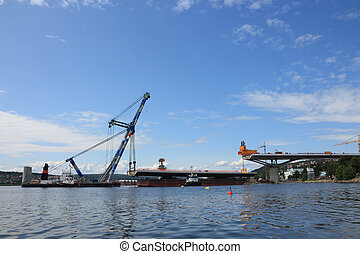 bridge lifted from a barge Public project tax financed:...