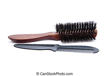 Hair comb with brush on white background