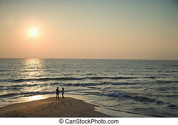 Couple on beach. - Birds eye view of couple on beach in Bald...