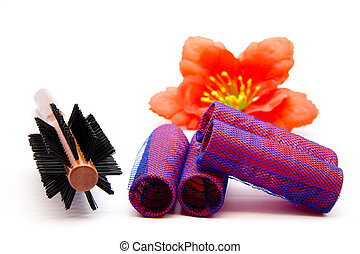 Locks roller with hairbrush on white background
