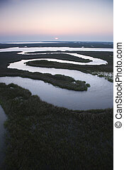 Winding water in marsh. - Aerial scenic view of winding...