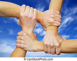 Linked hands on a white background symbolizing teamwork and...