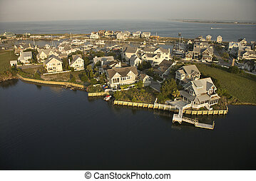 Homes on coast. - Aerial view of houses and ocean at Bald...