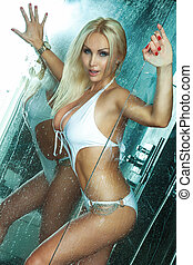 Sexy blonde beauty posing under the shower. - Sensual blonde...