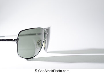 Sunglasses on white background and shadow