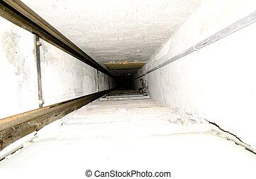 Inside an old elevator shaft
