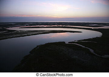 Meandering river. - Tidal creek meandering through wetlands...