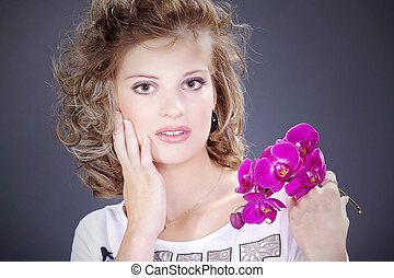 pretty blonde woman with orchid