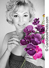 pretty woman with purple orchid