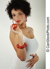 African american woman with tomatoes