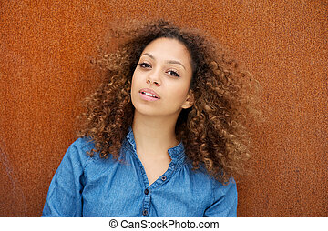 Attractive young woman with curly hair - Portrait of an...