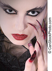 vampire woman with stiletto nails