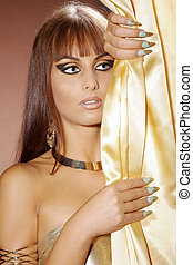 Beauty in Cleopatra style with great fingernails