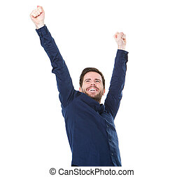Happy young man smiling with raised arms