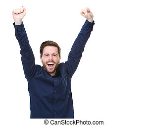 Happy man smiling with arms raised on isolated white...