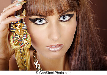 Beauty in Cleopatra style with statue