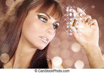 pretty woman in Cleopatra style looks at beauty serum in...