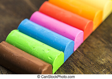 play dough - colors of play dough on the wooden table