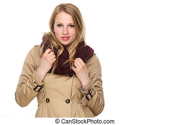 Beautiful young woman with winter coat and scarf - Closeup...