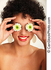 African american woman with flowers on the eyes