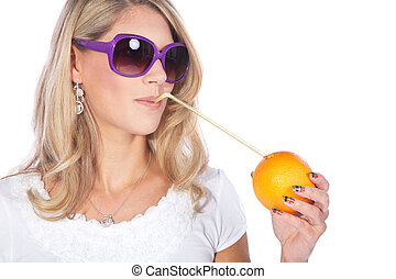 young woman drinking from orange