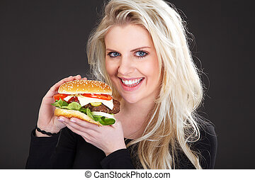 pretty woman with hamburger laughs