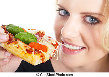 pretty woman eating pizza and smiling