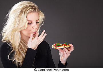 pretty woman eating pizza and enjoying