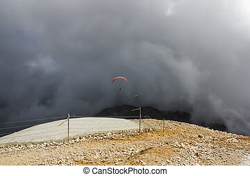 Paraglider flies from Mount Tahtali, Turkey - Multiple...