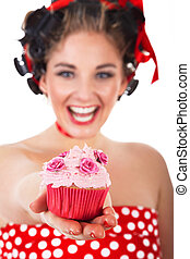 pretty woman with cupcake laughs