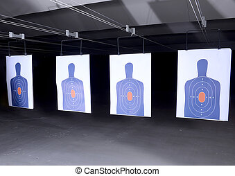 bullseye targets at gun range - bullseye targets lined up at...