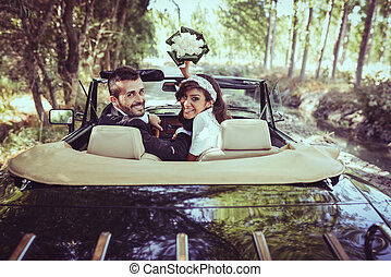 Just married couple in an old car - Just married couple...