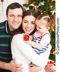 Happy family with near the Christmas tree - Happy smiling...