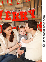 Happy family with near the Christmas background - Happy...