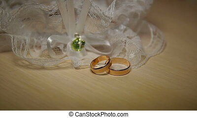 Wedding bands - Two wedding bands on a table. Close-up