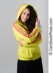 Young cheerful smiling woman in sports wear