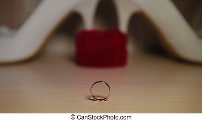Wedding rings - Two wedding rings on a table. Close-up