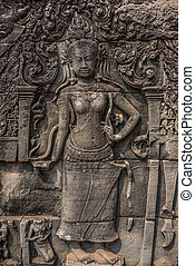 Apsara carved on the wall of the Elephant terrace, Angkor Thom. cambodia. Asia, Tradition, Culture and Religion.