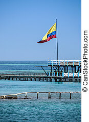 Seascape with colombian flag at Colombia, Cartagena de...