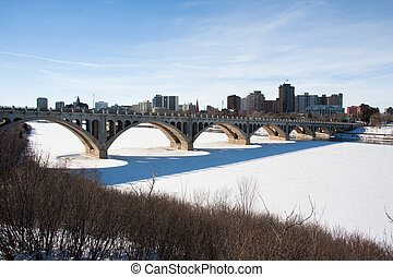 Bridge and downtown Saskatoon - A view of the University...