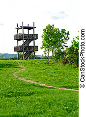 Bird watching tower in forest