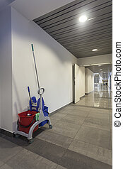 Mop and bucket - Cleaning set in a modern office building,...