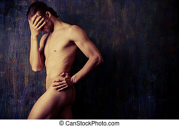 art nude - Sexual muscular nude man posing over dark...