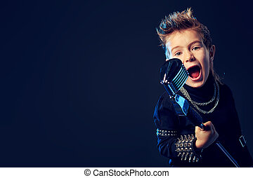 singing kid - Emotional little boy is singing into a...