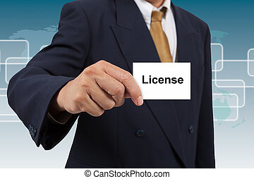 Businessman show a white card with word License