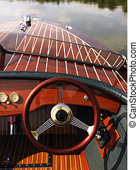 Steering wheel on boat - Wooden boat with steering wheel and...