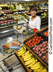Woman grocery shopping - Smiling middle aged African...