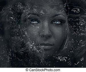 Immersion - Deep eyes. Beautiful woman in water