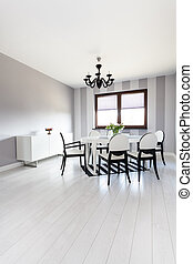 Vibrant cottage - Dining room with black and white colors